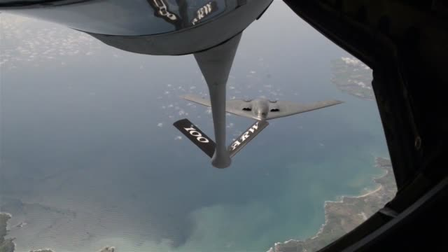 the 100th air refueling squadron refuels a b2 spirit from whiteman afb - stealth stock videos and b-roll footage