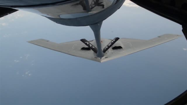 the 100th air refueling squadron refuels a b2 spirit from whiteman afb - stealth stock videos & royalty-free footage