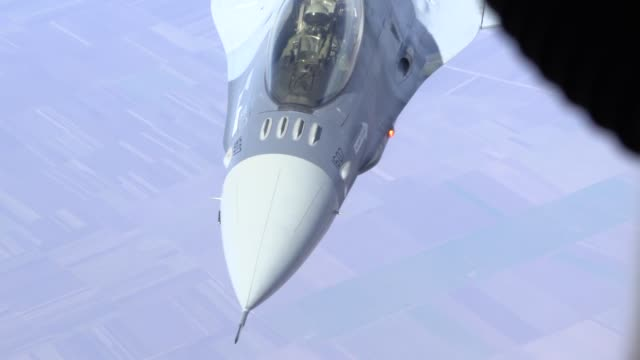 the 100th air refueling wing flew a kc135 stratotanker to romania to conduct air refueling training with romanian air force f16 fighting falcons - military training stock videos & royalty-free footage