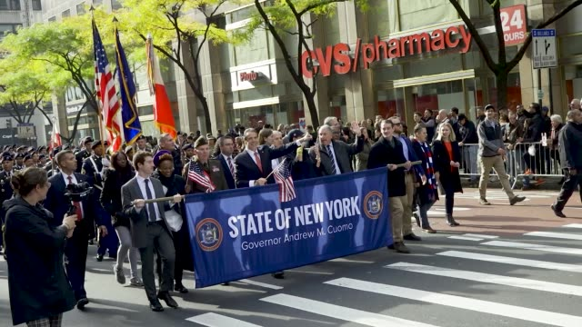 the 100th new york city veterans day parade, which is an annual event produced by the united war veterans council. - governor stock videos & royalty-free footage