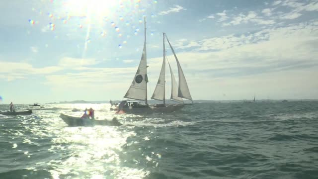 the 123 competitors of the route du rhum set off from saintmalo for guadeloupe - rum stock videos and b-roll footage