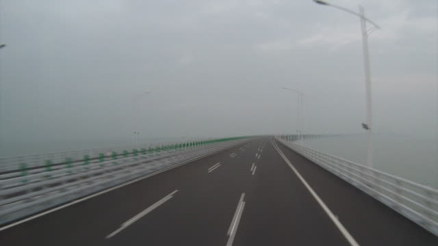 the $15 billion, 55-kilometer bridge is tipped to carry some 29,000 cars and trucks daily between zhuhai on the mainland and hong kong, a former... - macao stock videos & royalty-free footage