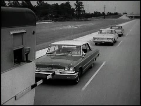 the 1963 chevrolet impala with the 327 v8 takes on the competition for passing power each car tries to pass a pickup truck towing a trailer in the... - chevrolet stock videos & royalty-free footage