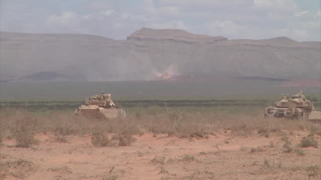 the 1st armored division's 2nd brigade combat team kicked off the monthlong iron focus exercise with a joint fire coordination exercise may 10 iron... - armoured vehicle stock videos & royalty-free footage