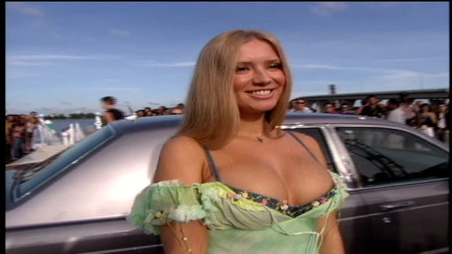 the 2005 miss russia julia kova posing for pictures on the red carpet. - 2005 stock videos & royalty-free footage