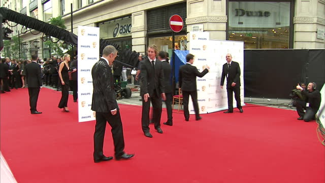 the 2010 baftas held at the royal opera house london shows exterior shots of television host and comedian graham norton posing for photographers on... - graham norton comedian stock videos & royalty-free footage