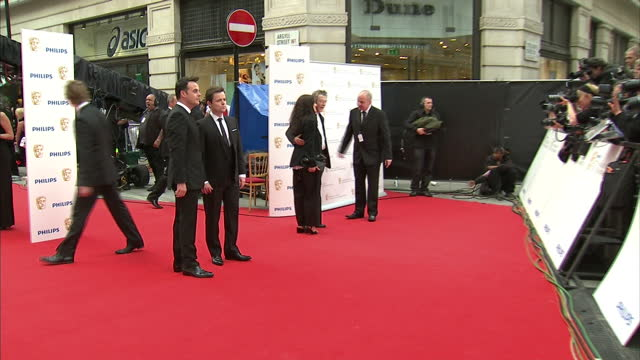 stockvideo's en b-roll-footage met the 2010 baftas held at the royal opera house london shows exterior shots of ant and dec posing for photographers on the red carpet - ant mcpartlin