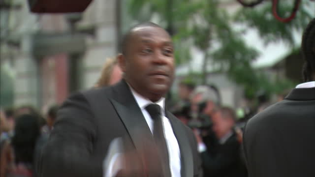 the 2010 baftas held at the royal opera house, london. shows exterior shots of dance group diversity posing for photographers with lenny henry on the... - lenny henry stock videos & royalty-free footage
