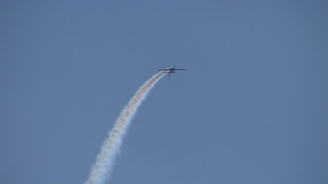 the 2013 chicago air and water show attracted 1.7 million spectators. extra 300 aircraft creating formation in the sky on august 16, 2013 in chicago,... - chicago air and water show stock videos & royalty-free footage