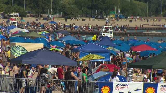 the 2013 chicago air and water show attracted 1.7 million spectators. crowd watching air and water show on august 16, 2013 in chicago, illinois - chicago air and water show stock videos & royalty-free footage