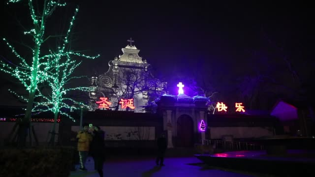 the 2014 lights of christmas are launched at a church on december 23, 2014 in beijing, china. - fairy lights stock videos & royalty-free footage