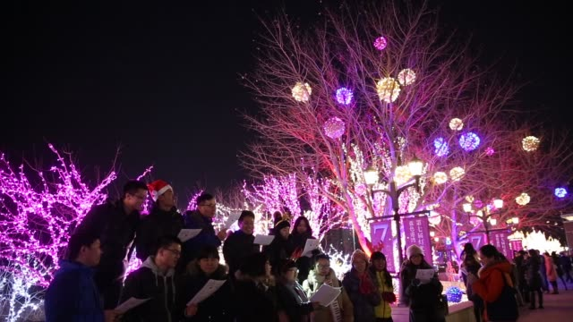 the 2014 lights of christmas are launched at a shopping centre on december 23 2014 in beijing china - chorsänger stock-videos und b-roll-filmmaterial