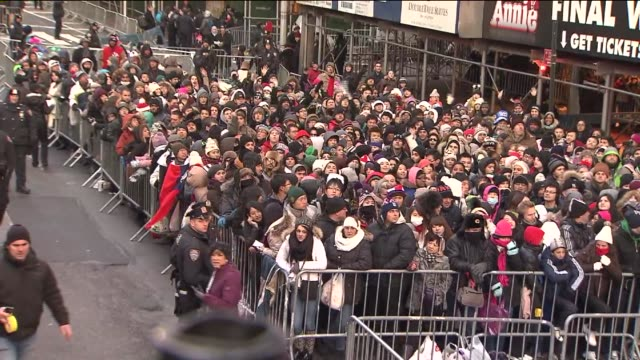 the 2014 new year's eve ball drop crowds prep for new year's eve ball drop at one times square on january 01, 2014 in new york, new york - theatre district stock videos & royalty-free footage