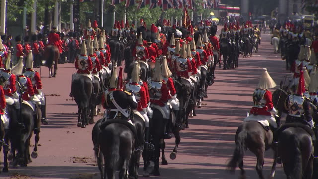 the 2018 trooping the colour progresses down the mall, where regiments of the british and commonwealth armies parade in front of buckingham palace,... - (war or terrorism or election or government or illness or news event or speech or politics or politician or conflict or military or extreme weather or business or economy) and not usa stock videos & royalty-free footage