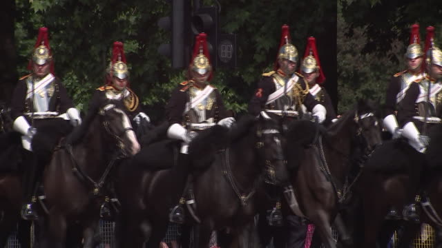 the 2018 trooping the colour, where regiments of the british and commonwealth armies parade in front of buckingham palace, in addition, marks the... - (war or terrorism or election or government or illness or news event or speech or politics or politician or conflict or military or extreme weather or business or economy) and not usa stock videos & royalty-free footage