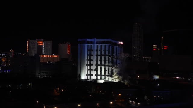 the 24story monaco tower at the shuttered riviera hotel casino is imploded on june 14 2016 in las vegas nevada the 60year old las vegas strip resort... - imploding stock videos and b-roll footage