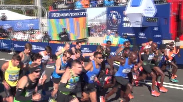 the 26.2 mile marathon starts in staten island on the verrazano bridge. elite runners are off. - salmini stock videos & royalty-free footage