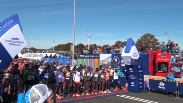 the 26.2 mile marathon starts in staten island on the verrazano bridge. elite runners are off the line first - salmini stock videos & royalty-free footage