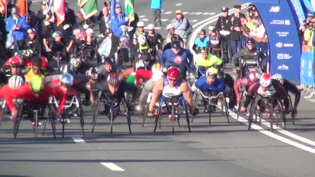 the 26.2 mile marathon starts in staten island on the verrazano bridge. wheelchairs are off the line first. - salmini stock videos & royalty-free footage