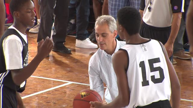 wgn the 2nd annual peace basketball tournament held at st sabina church allows young men from rival gangs on chicago's south side to play in a... - jump ball stock videos and b-roll footage