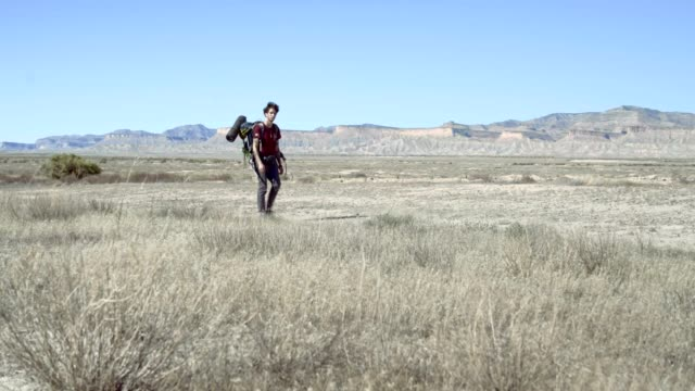 the 30-years-old man travel with backpack in the desert wilderness in utah, usa - 30 34 years video stock e b–roll
