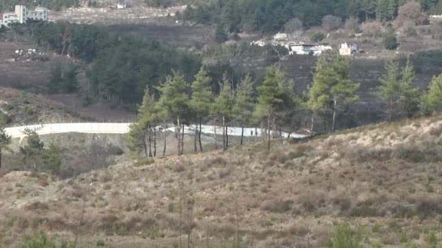 the 3m high and 2m wide concrete blocks are placed along the turkish-syrian borderline in yayladagi district of hatay, turkey on january 11, 2017.... - concrete wall stock videos & royalty-free footage