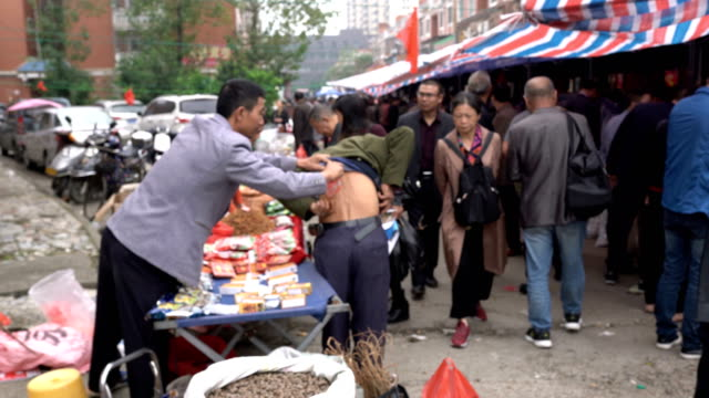 the 49th chinese medicine fair in zhangshu city, - tradition stock videos & royalty-free footage