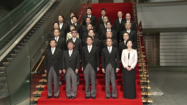 the 4th abe cabinet is launched photo session at the prime minister's office up shot of prime minister shinzo abe deputy prime minister/ finance... - 選挙点の映像素材/bロール