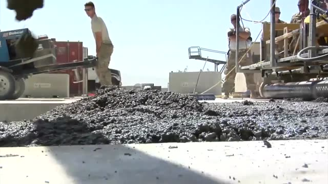 the 557th expeditionary rapid engineer deployable heavy operational repair squadron , located at bagram airfield is making runway repairs to un-sound... - bagram air base stock-videos und b-roll-filmmaterial