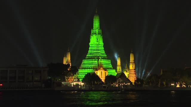 the 66.8-meter-high main pagoda and the other four pagodas of the arun temple shine emerald green light as the bangkok metropolitan administration... - pagoda stock videos & royalty-free footage