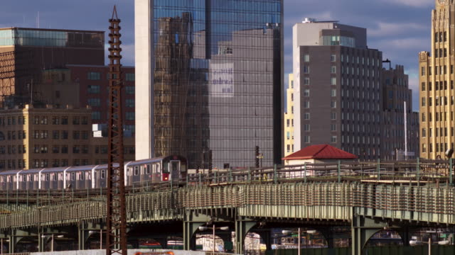 The 7 elevated subway train crosses an elevated portion of track in Long Island City New York.