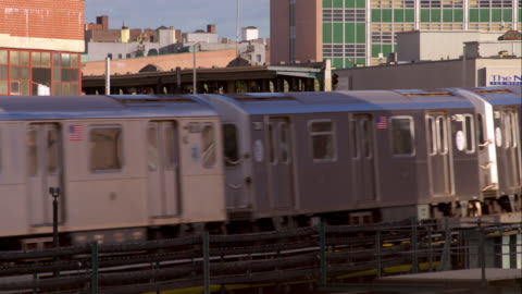 the 7 elevated subway train pulls into the station in long island city new york. - elevated train stock videos & royalty-free footage