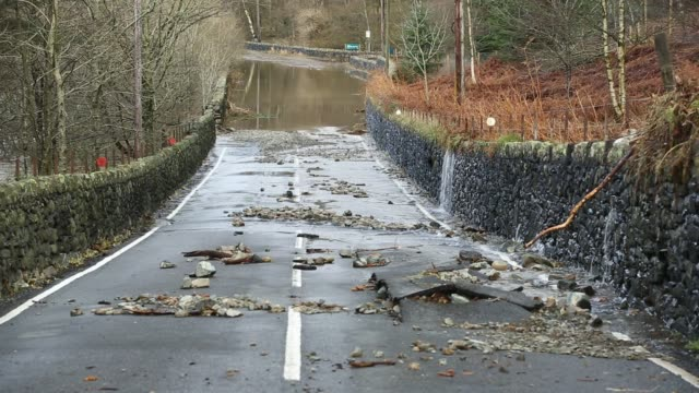 the a591, the main road through the lake district, completely destroyed by the floods from storm desmond, cumbria, uk. - torrential rain stock videos & royalty-free footage
