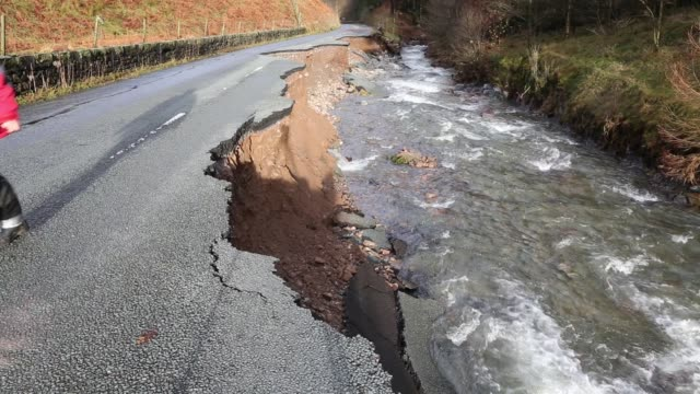 the a591, the main road through the lake district, completely destroyed by the floods from storm desmond, cumbria, uk. - flood stock videos & royalty-free footage