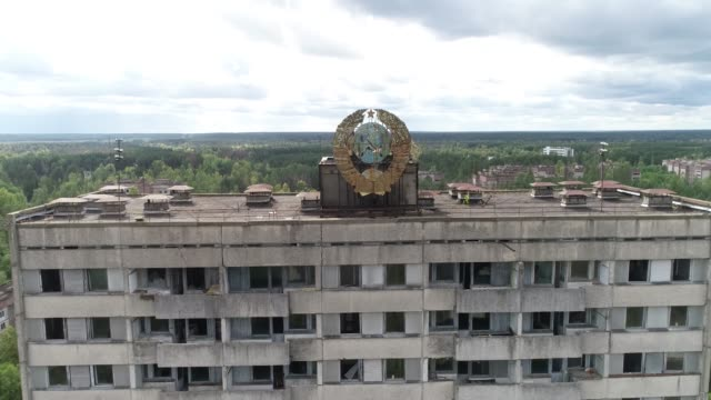 the abandoned city is still shot by a drone house moving away from it with a coat of arms on the roof - former soviet union stock videos & royalty-free footage