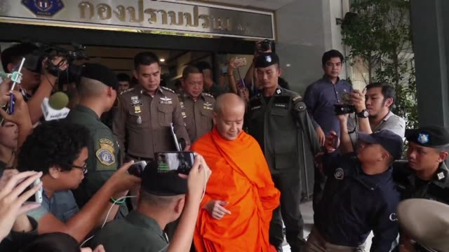 The abbot of the Golden Mount temple in Bangkok suspected of embezzlement after $4 million was found in bank accounts to his name surrenders to police