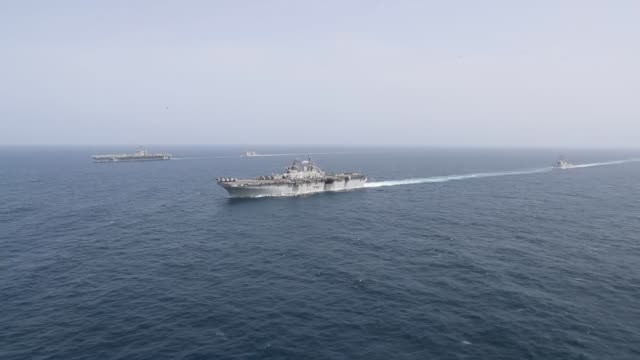 the abraham lincoln carrier strike group and kearsarge amphibious ready group transit the arabian sea while conducting joint operations, may 17 2019. - aircraft carrier stock videos & royalty-free footage