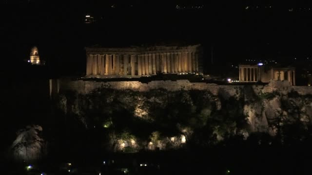 the acropolis in athens goes dark to raise awareness about climate change as part of the global earth hour campaign - earth hour stock videos & royalty-free footage