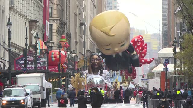 the adorable suit-wearing, briefcase-carrying boss baby balloon has been unveiled during the 94th annual macy's thanksgiving day parade on november... - parade stock videos & royalty-free footage