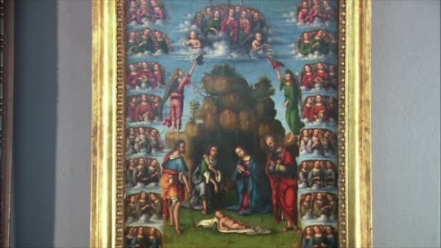 ms the adoration of the shepherds with angels by lorenzo costa, oil on wood, circa 1499 / the national gallery, london, united kingdom - 新約聖書点の映像素材/bロール