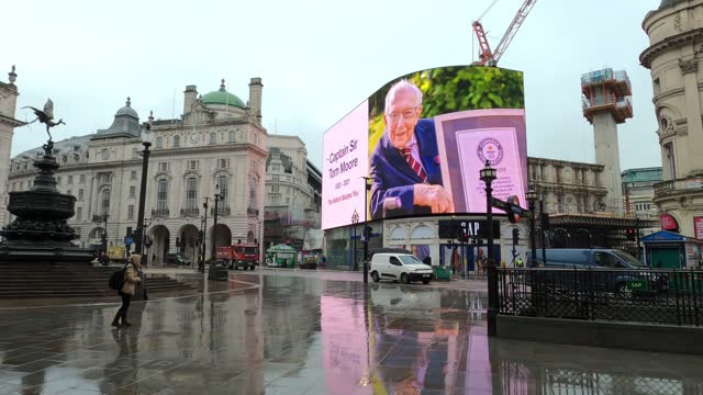 the advertising screens at piccadilly circus in central london display a memorial to captain sir tom moore at midday on february 3, 2021 in london,... - famous place stock videos & royalty-free footage
