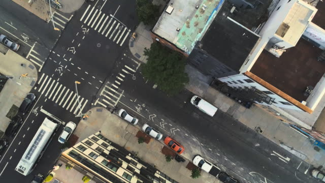 the aerial directly above view of the crosswalk in the residential district in brooklyn, nyc. panoramic and descending camera motion. - brooklyn new york stock videos & royalty-free footage