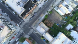 The aerial directly above view of the crosswalk in the residential district in Brooklyn, NYC. Panoramic camera motion.