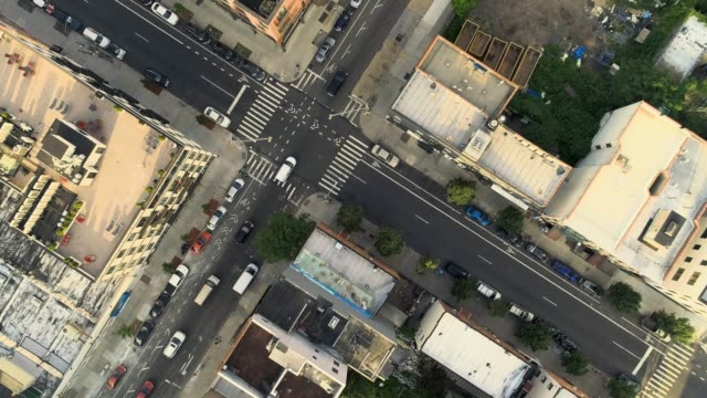 the aerial directly above view of the crosswalk in the residential district in brooklyn, nyc. panoramic camera motion. - brooklyn new york stock videos & royalty-free footage