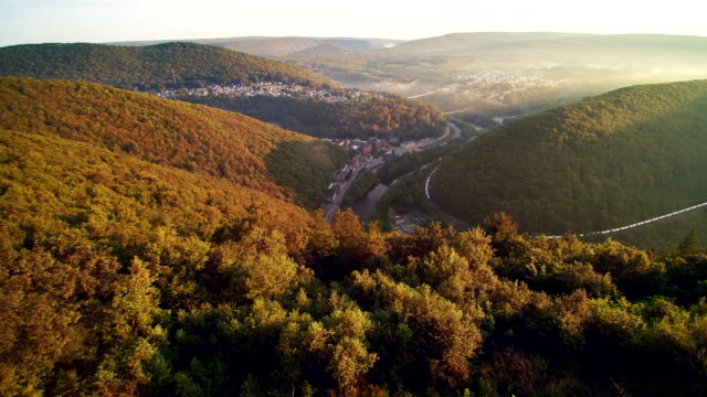 the aerial drone view of the jim thorpe (mauch chunk) and lehigh river in carbon county, poconos region, pennsylvania, usa - pennsylvania stock videos & royalty-free footage
