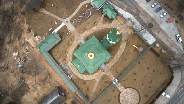 The aerial drone view to Orthodox Church in the small village Vishnevo, Belarus, Eastern Europe
