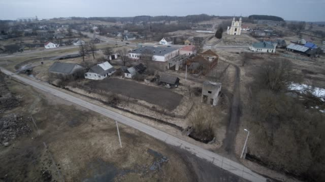 the aerial drone view to orthodox church in the small village vishnevo, belarus, eastern europe - elevator point of view stock videos and b-roll footage