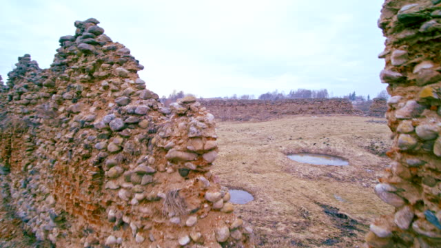 The aerial drone view to the ruined, totally destroyed stone walls of the historic castle in Kreva, Belarus. Was built in 1382. This is the historic place for Belarus, Lithuania and Poland.