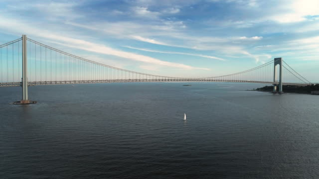 the aerial drone view to verrazano-narrows bridge between brooklyn and staten island, new york, usa - staten island stock videos and b-roll footage
