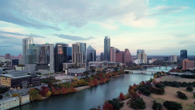 the aerial drove view of austin downtown, texas, usa, from auditorium shores at town lake park across colorado river. aerial drone video with the panoramic camera motion. - texas stock videos & royalty-free footage